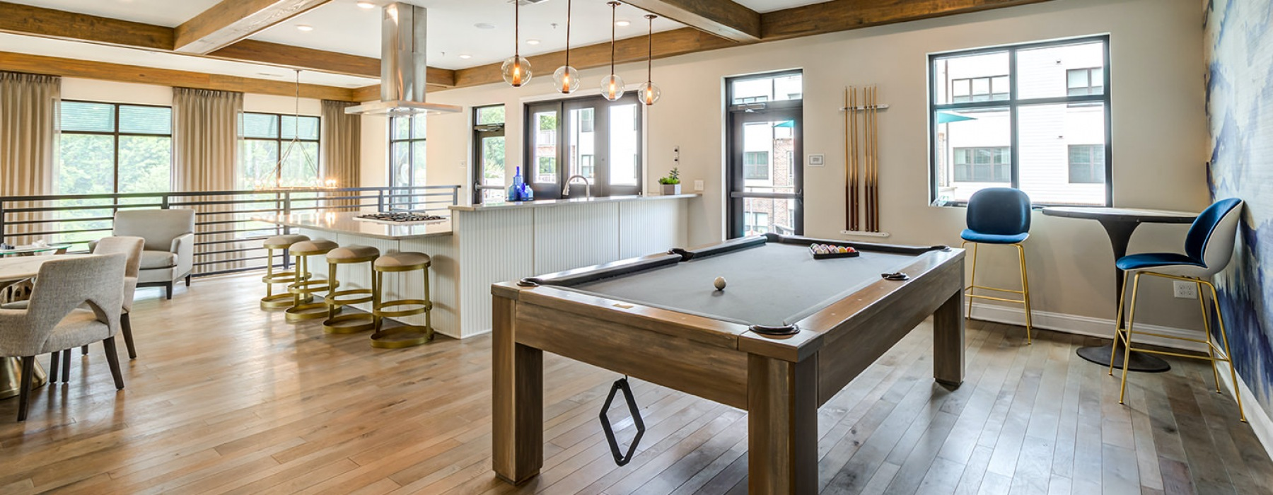 Loft, clubhouse space with lots of windows, pool table, and community kitchen